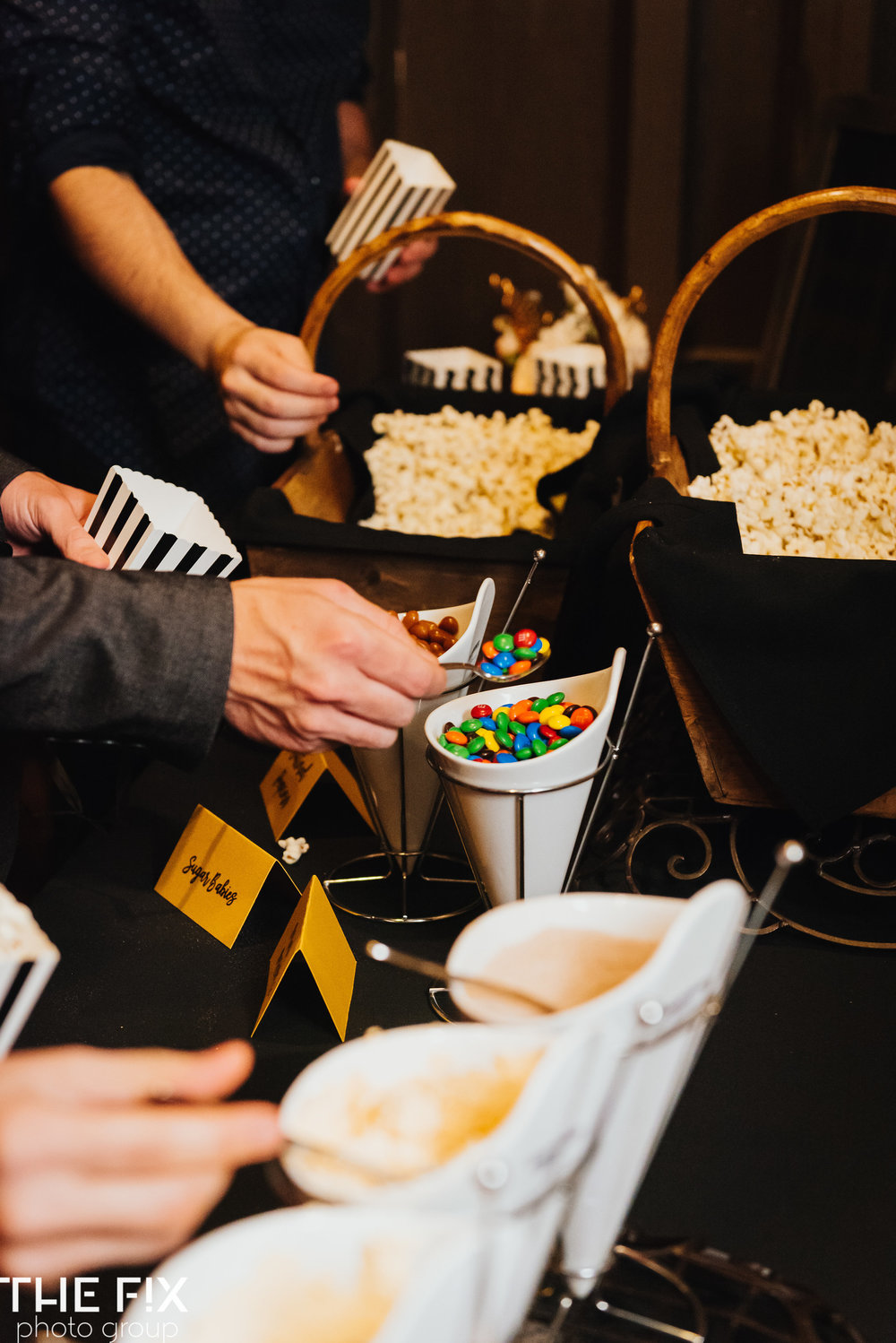 guests enjoy at candy bar at  Corporate holiday party entertainment at Herban Feast , photographed by the Fix Photo Group