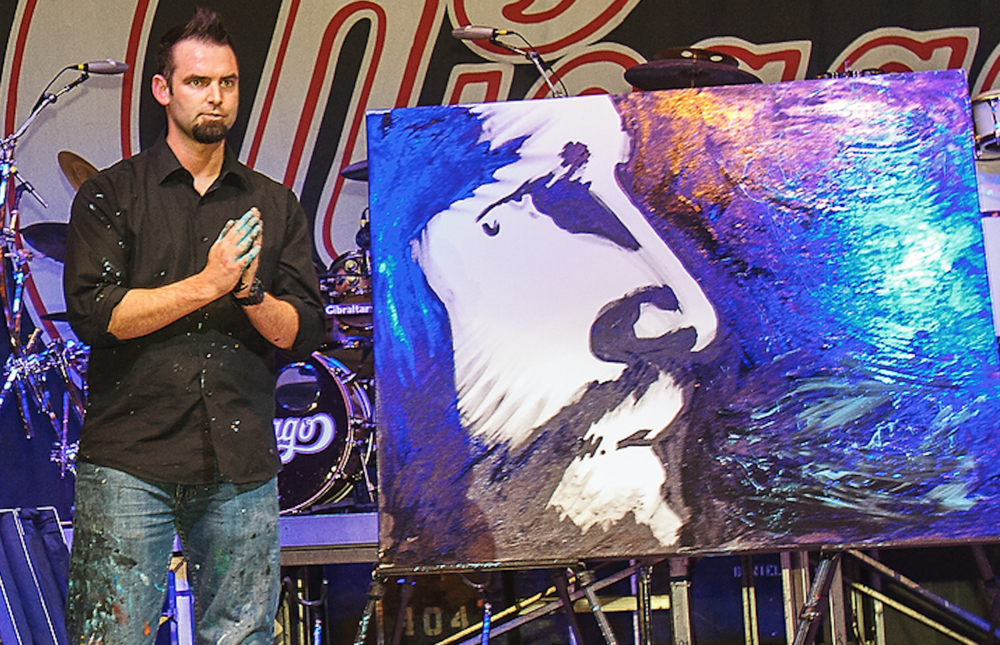 Artist and speed painter, Lance Brown thanking the crowd for a standing ovation at the Dallas Catholic Charities Bishop's Gala 2015