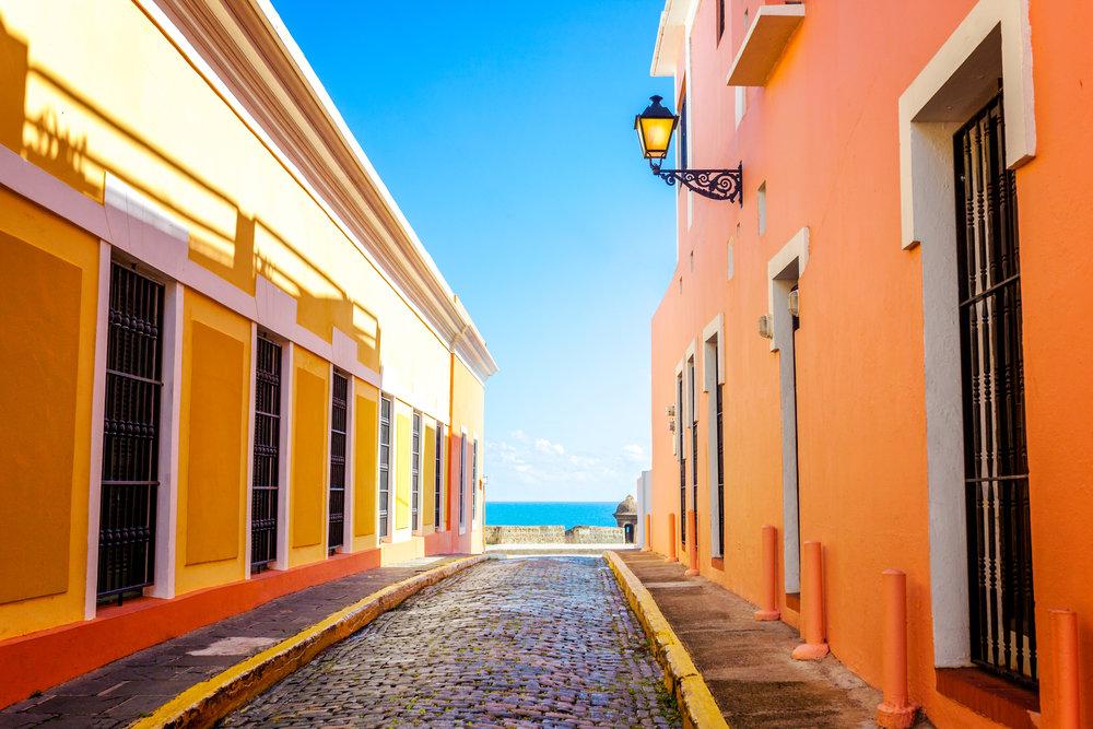 A colorful street leading to the ocean, San Juan, PR