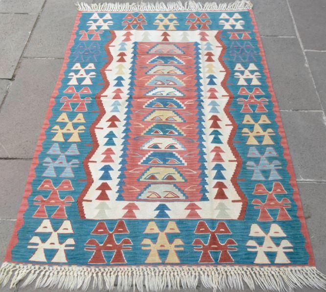 flat weave tribal rug.JPG