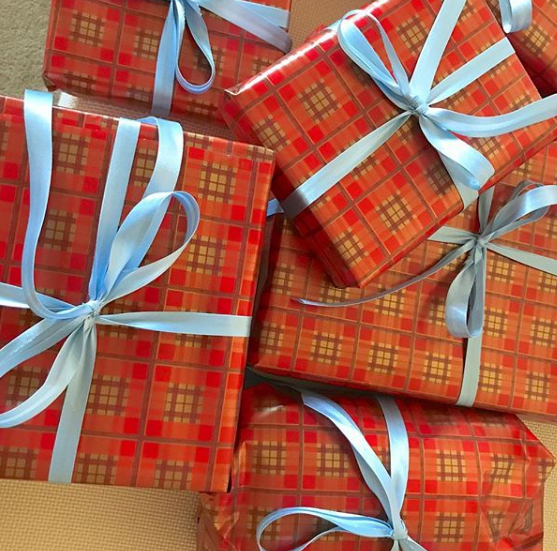 Wrapped my gifts in plaid wrapping paper (local shop) & blue ribbon (my mom's closet)!