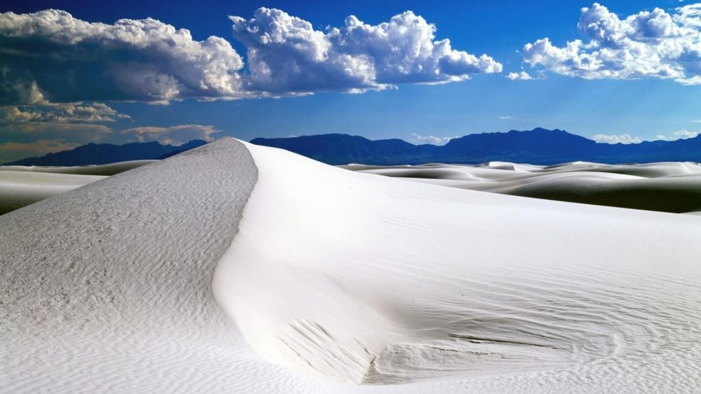 White Sands National Monument  Want more of Mother Nature's handy work in Southern New Mexico?   White Sands National Monument  lies just 13 miles west of Alamogordo.  Visit the museum to learn how the white sand was formed and then tour the sand dunes by foot or by car.  It is a magical place to visit.