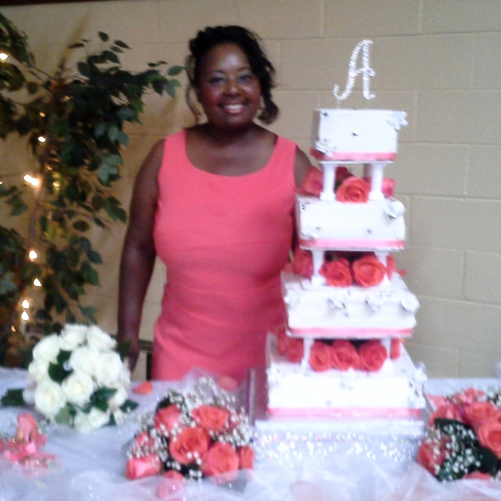 Deborah Brown of Sweetdele's Sweet Treats with wedding cake