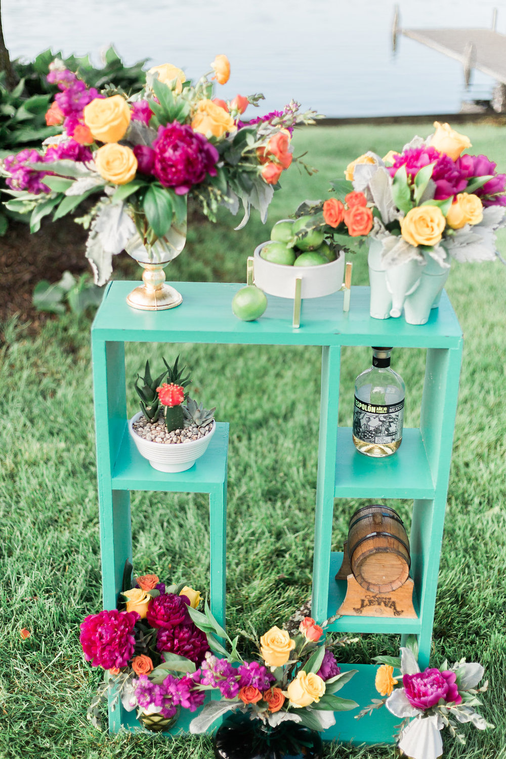 This is my life; flowers, tequila, bright colors, and lake life.  Photographer:  Cynthia Boyle