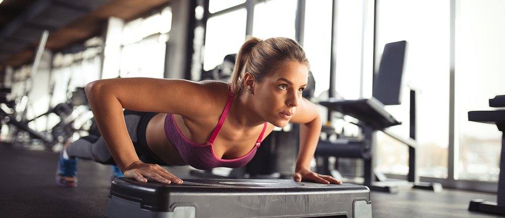 iStock-female doing push-ups on the step board 618196974.jpg
