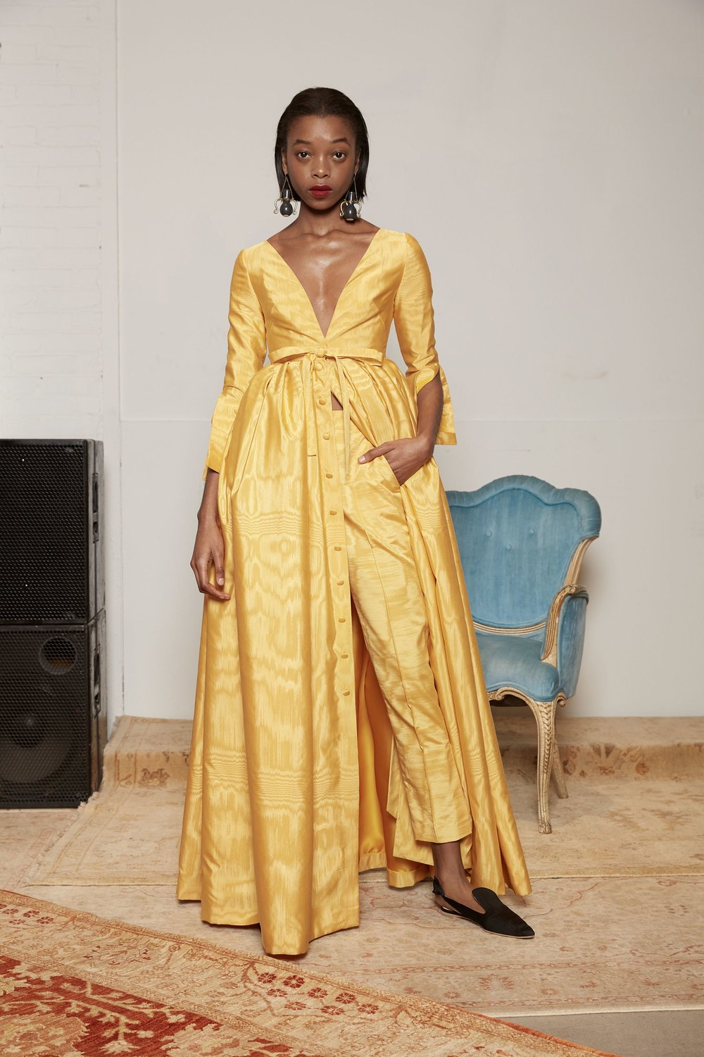 We love Assoulin's gold, button-down v-neck gown. A stunning, classic option for maids, guests and maybe even your M.O.B.