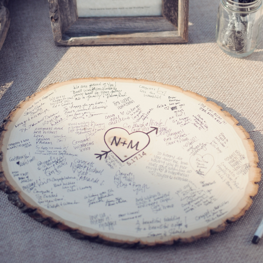 2. Wood guestbook - We are also obsessed with this wood slice guestbook alternative! It's a fun way to put your guests names and best wishes on display for everyone to see during the reception! This unique wood sign is perfect for brides who are looking for a wedding keepsake that will last a lifetime. Photography by Alea Moore. See the full wedding, here!