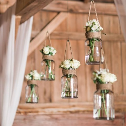 3. hanging jar vases - These mason jar vases are perfect for hanging floral arrangements from trees for any outdoor wedding. Hang the jars with thick twine and add wildflowers for an extra rustic vibe! These vases are such a unique way to showcase flowers and are a must for any farm inspired wedding! Photography by Angela Scheiderich. See the full wedding, here!