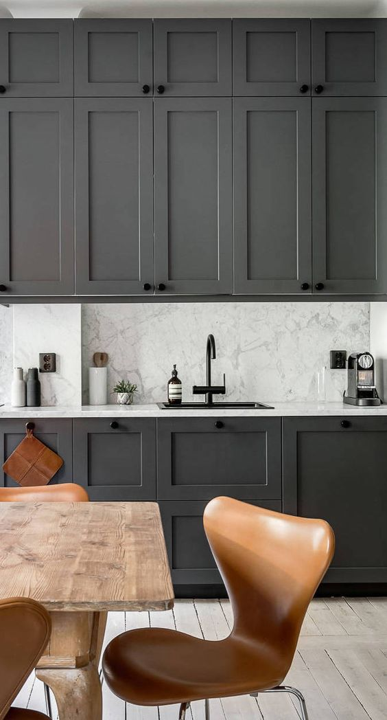 Marble stone bench tops, and continued up the splash back.
