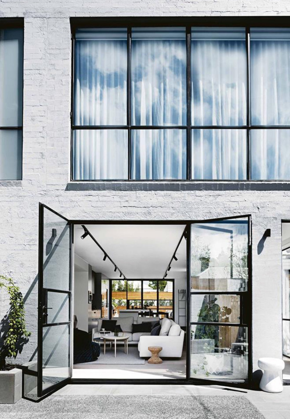 White brick, black window frames.