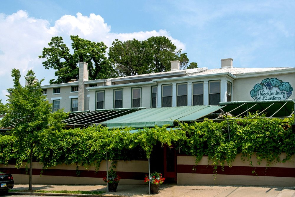 Mecklenburg's historic Bier Garden with a full canopy of 150 year old grape vines draping the trellises