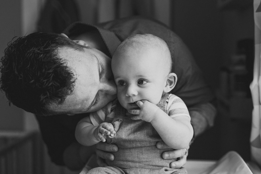 thomas wywrot photography nashville family photographer in home newborn infant baby indoor photos pictures tennessee tn natural light candid lifestyle woodbine brentwood franklin father kisses