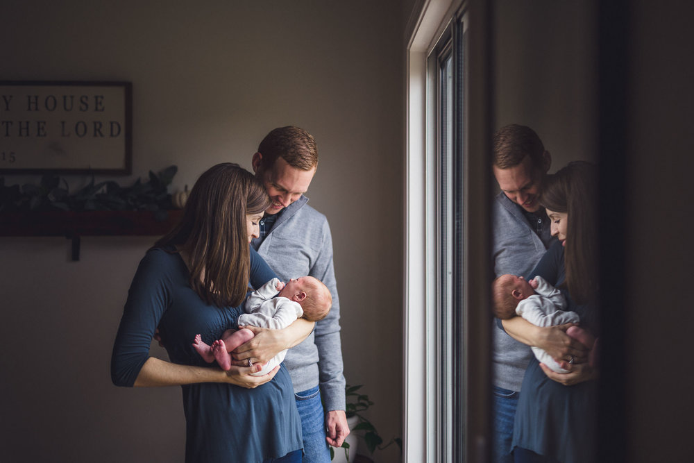 thomas wywrot photography nashville newborn photographer artistic photo reflection father mother holding baby two weeks old lifestyle session