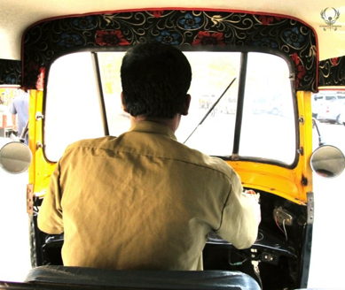 The rickshaws in Mumbai are small but can seat two people behind the driver.