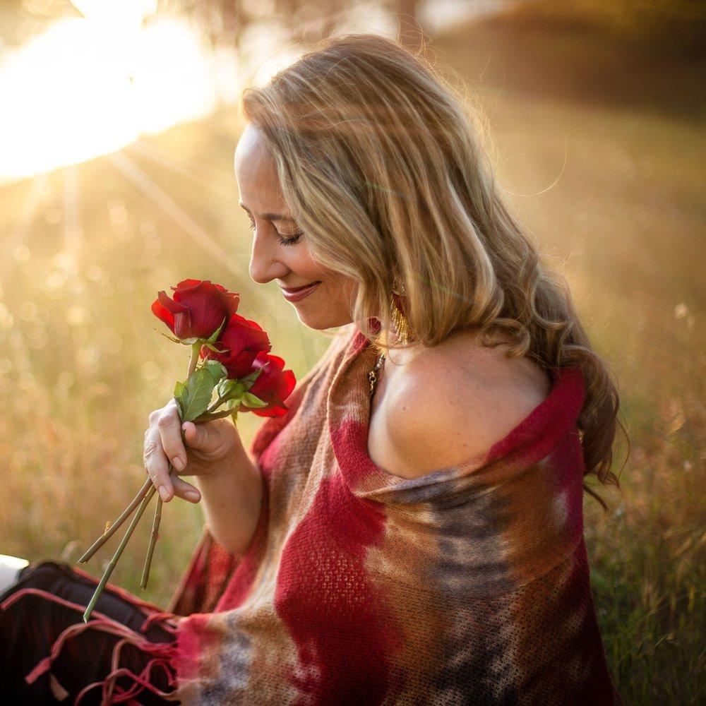 Eva smelling roses.jpg