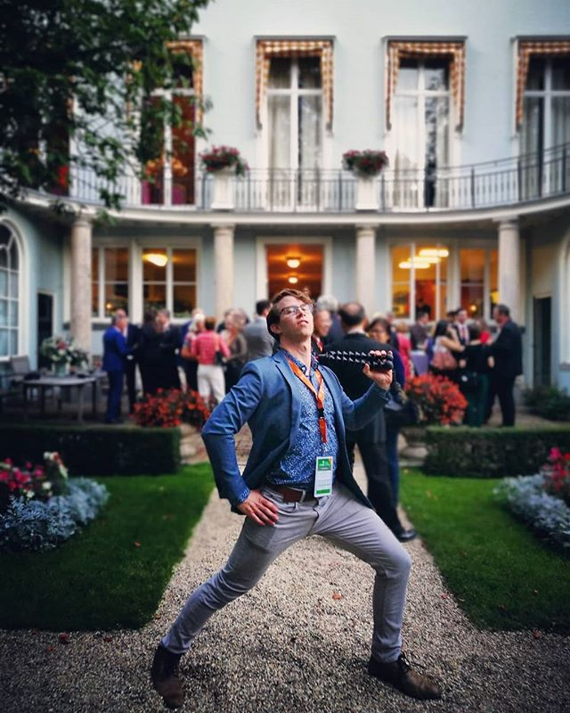 So, I'm rather proud of this photo. Last night we got invites to meet the Mayor of Amsterdam at her house for a private garden reception. And so, this is me looking partially fly in the mayor's backyard. I have no idea how to act professional gatherings. :-/