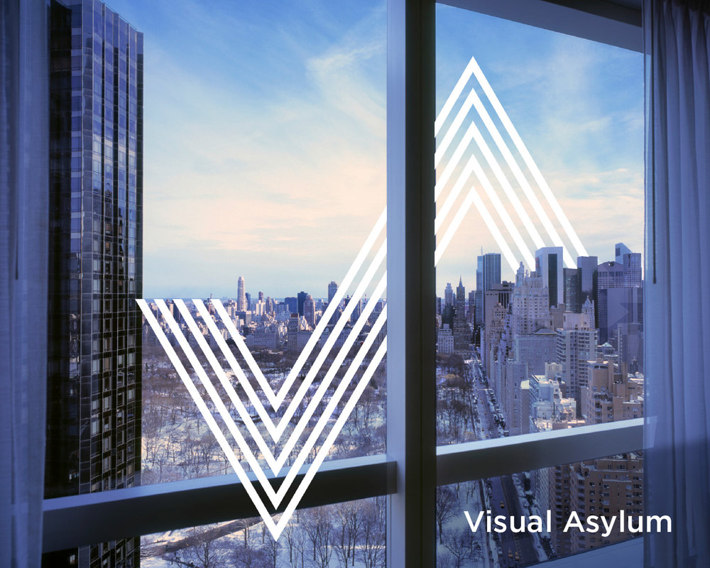 Visual Asylum logo set against a city skyline