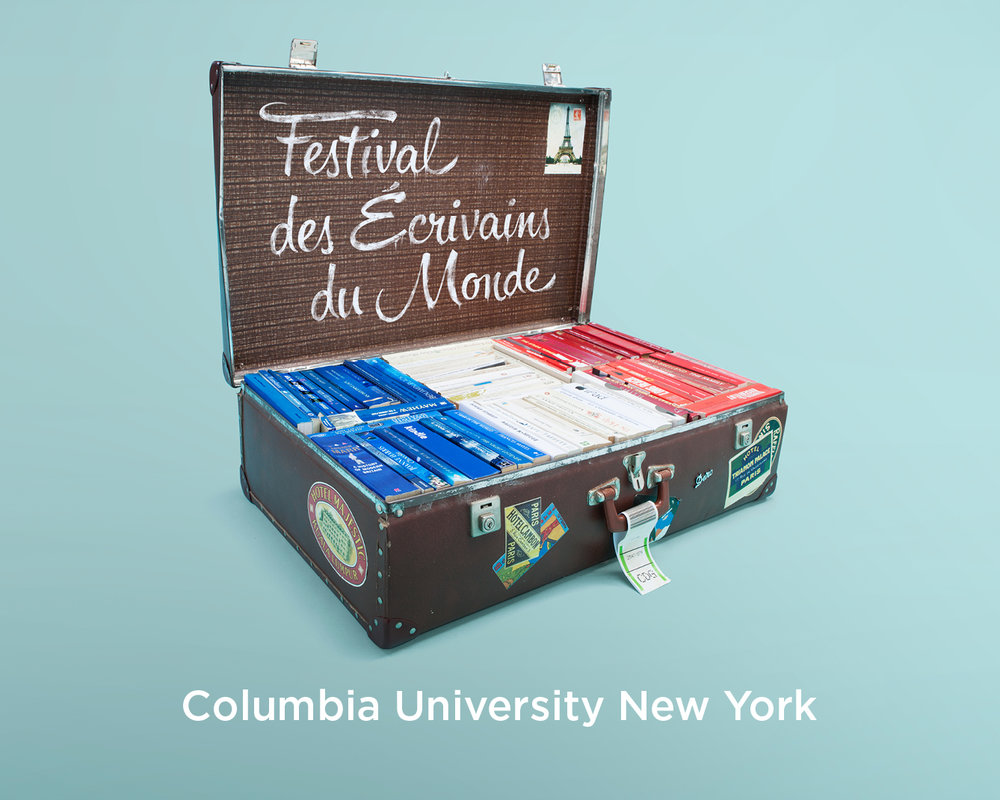 Large suitcase filled with blue, white & red books