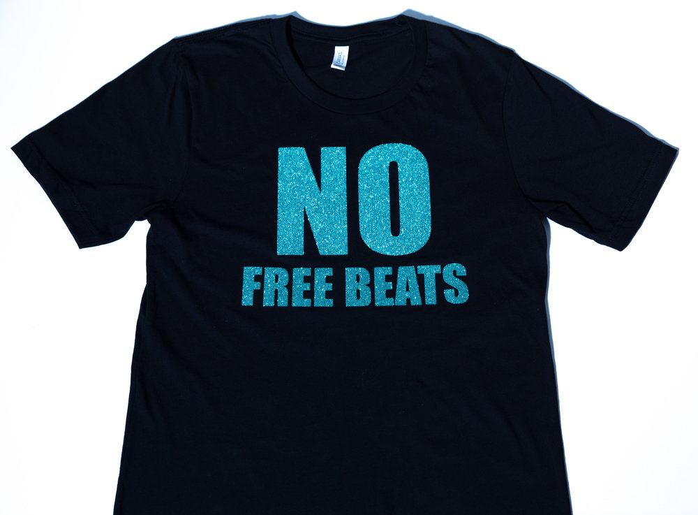 No Free Beats T- Shirt Movement - Now you can get your custom No Free Beats Custom Vinyl Bling T-Shirt. Comes in sizes S,M,L,XL, XXL . Please specify size in the notes section of your paypal checkout. Now only $25 with Free Shipping. Allow 7 -10 days