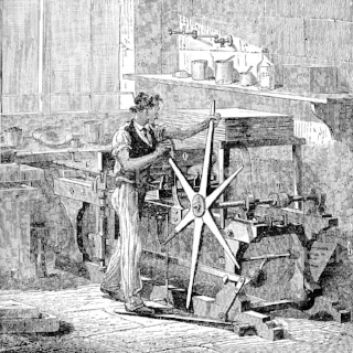engraving-man-with-lithography-press-in-workshop-1882-illustration-id157564107.jpg