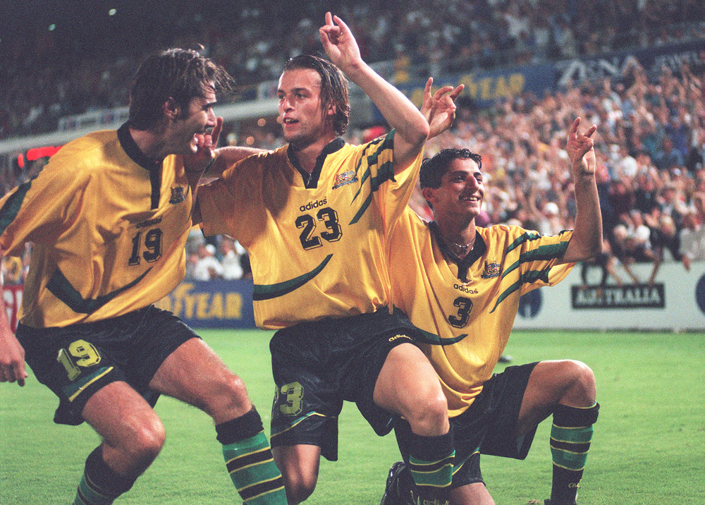 As a former Socceroo representing Australia on the international field, Michael (centre) knows the importance and value of exercise.