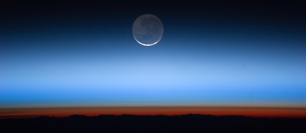 "Image by NASA's Earth Observatory, ""Hovering on the Horizon."""