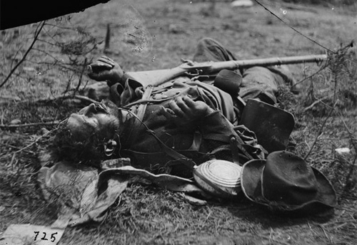 Another deceased soldier of Ramseur's Brigade, note the slouch hat, Federal bullseye pattern canteen with leather strap, a dark jacket and a Federal double bag knapsack. He is armed with an Enfield rifle (note: rifle could also be a photographer's prop). (LOC#: LC-B811- 725)