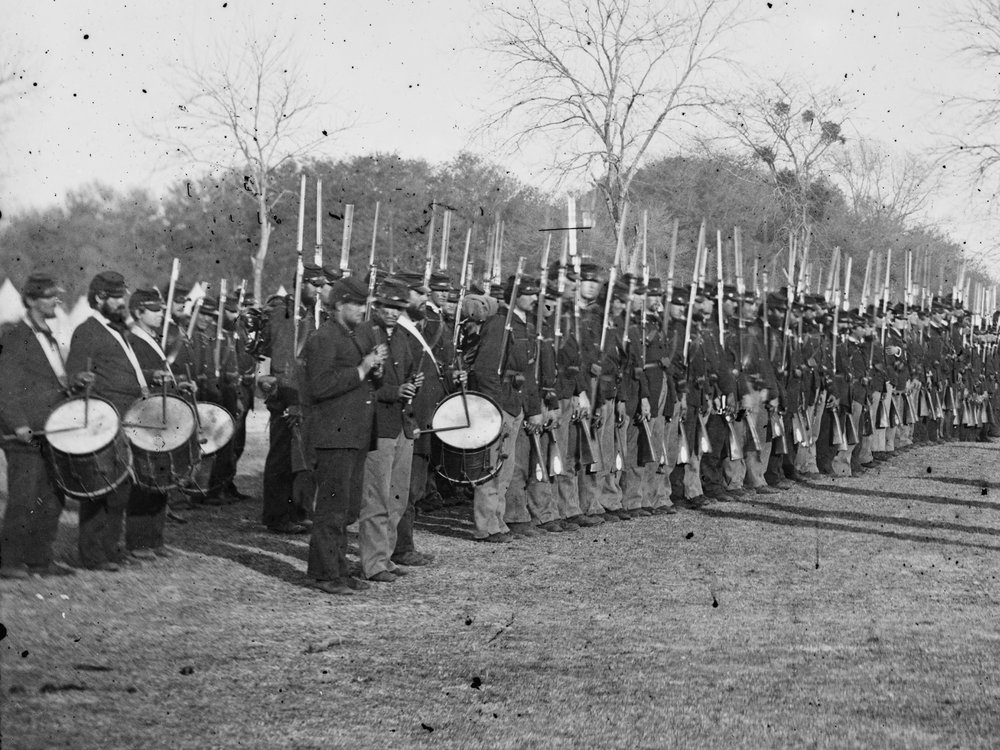 February, 1862. While some units were still completely outfitted with dark blues, others like the 50th Pa. already began seeing some light blues in the ranks by early 1862. (LOC#: LC-B811-156A)
