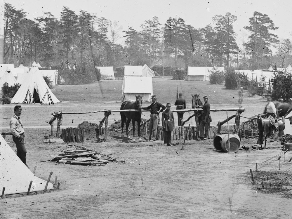 May, 1862.  HQ of Gen. George B. McClellan, Camp Winfield Scott, near Yorktown, Va. Five men are seen wearing dark blues - including the man sitting by the rifle stacks at the left edge of the photo. (LOC#: LC-B811-367A)