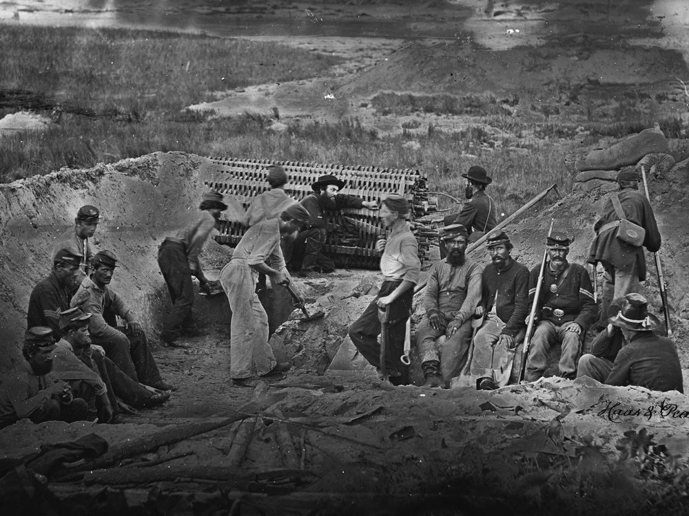 July or August, 1863 These men building fortifications on Morris Island, SC are wearing an assortment of sky blues, dark blues, and even what appear to be work pants made of white cotton drill. (LOC#: LC-B8156-17)