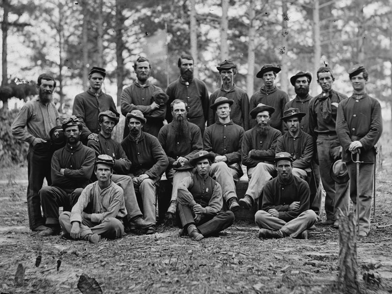 August, 1864 Petersburg, Va. The two Sergeants within this group of men from Co. B of the Engineer Battalion are wearing dark blues. (LOC#: LC-B817-7219)