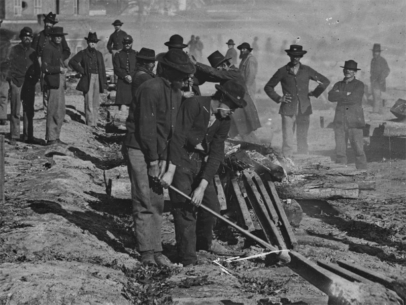 September, 1864  Atlanta, Ga. Shown are Sherman's men destroying railroad. A man in the foreground is seen wearing dark blue pants. (LOC#: LC-B811-3630)