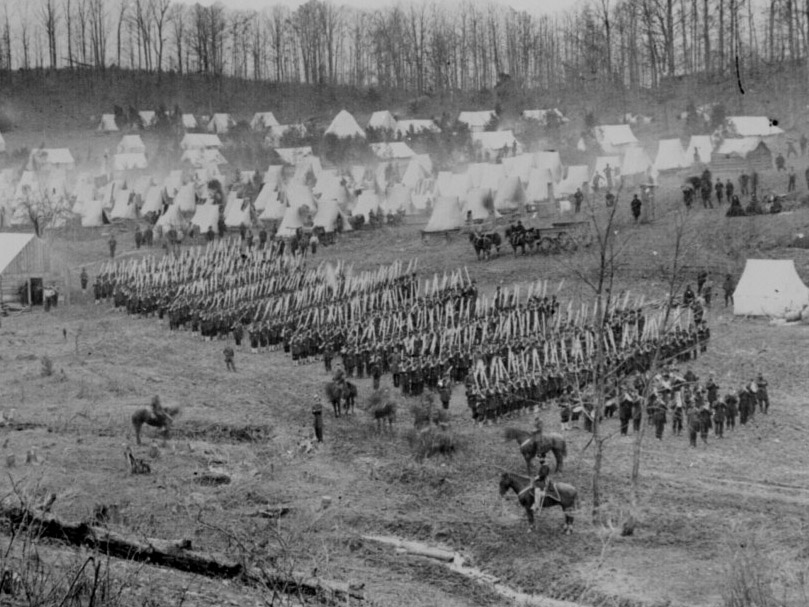 February 26, 1862. A well known photograph of the 96th Pa. at Camp Northumberland. Notice their full dress uniforms: frocks, dark blues, dress hats, and some companies with gaiters. (NA#: 111-B-487)