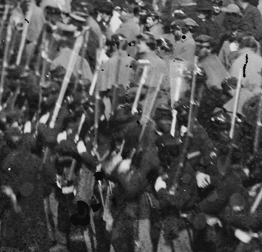 Soldiers in the crowd at the Grand Review, 1865, showing slight degrees of variation among individuals, though staying somewhat true to the manual.