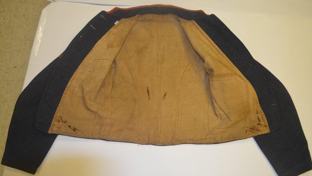 "Henry Redwood Jacket (buttons on left side – possible ""goof"")"