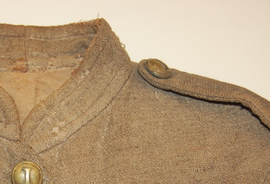 Abraham Adler jacket – jeans weave, gray dyed wool on natural cotton warp (note unfaded area under epaulette)
