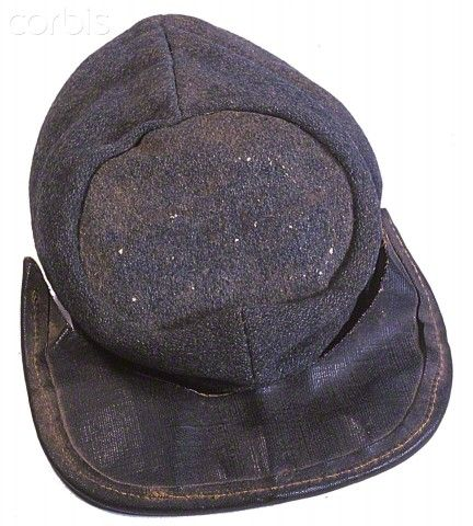 A typical Richmond Clothing Bureau kepi made of blue grey wool with a machine bound oilcloth brim