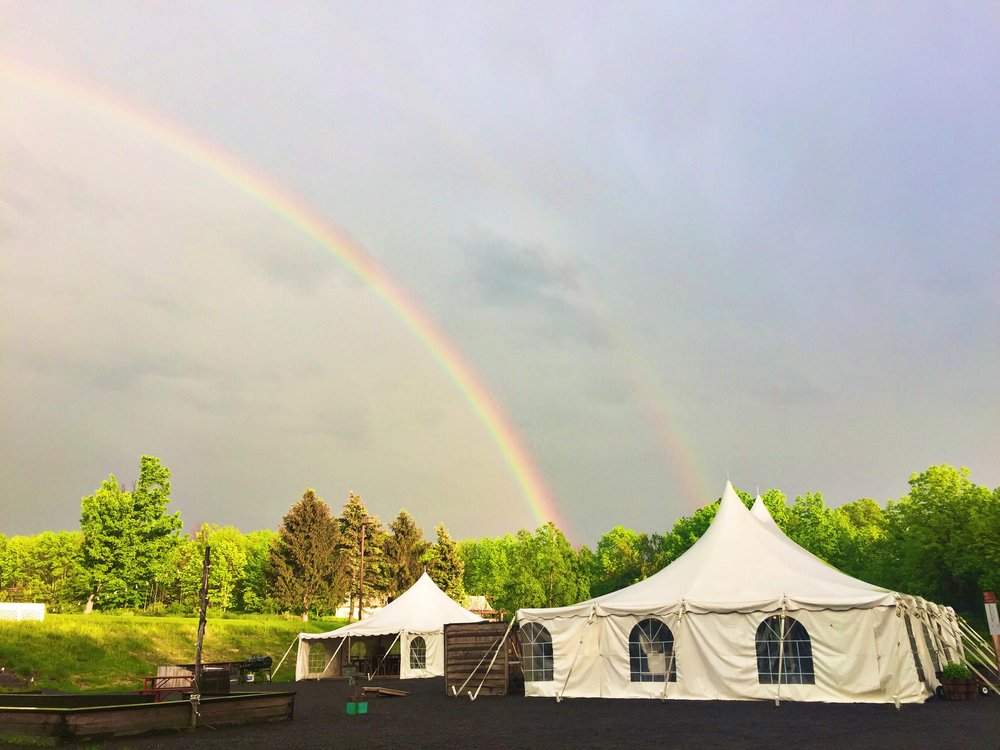 Double rainbows over the canteen tent at Firelight Camps