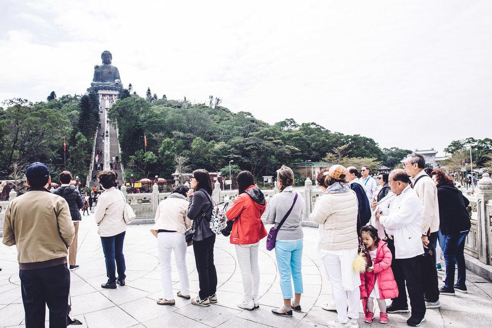 Tourists wait
