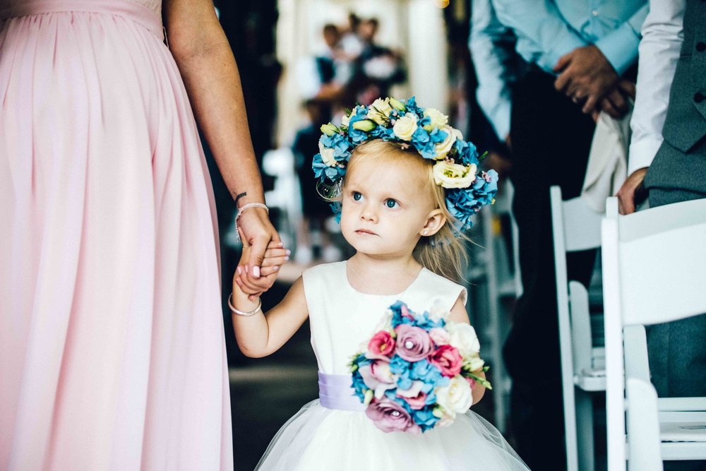 The flower girl makes her entrance