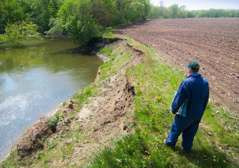 Vegetation on this riverbank would both prevent erosion as well as filter nutrients from the adjacent field. This is an extreme example of what the buffer law intends to prevent