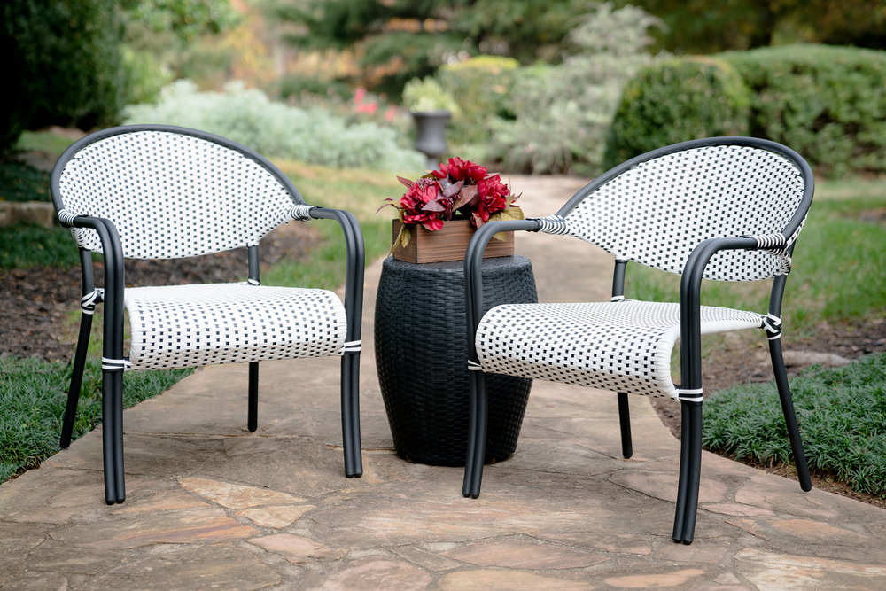 Monticello Bistro - Tight on space? Give your balcony or front porch a stylish makeover with our classic Parisian inspired bistro set. Enjoy your morning coffee on the comfortable hand-woven wicker chairs and side table. The Monticello comes in two color options: black & white or white & blue. Which do you like more?