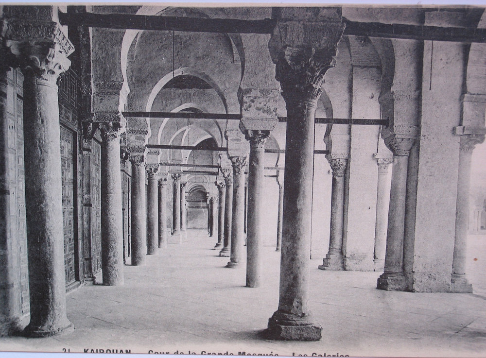Ancient Roman columns in Islamic hypostyle hall. The Prayer hall of the Great Mosque of Kairouan, Tunisia. Vintage postcard.