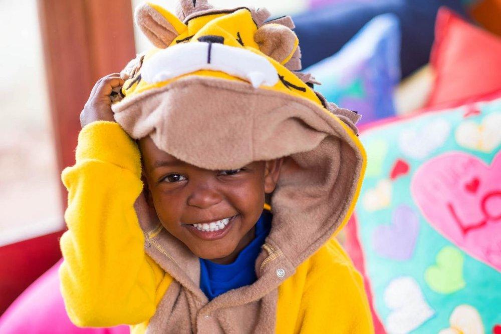Thanda-ECD-onesie-smile-2.jpg