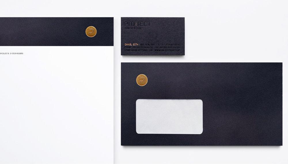 Coporate Design für Project, Veredelung und Blindprägung auf schwarzem Hintergrund von den sons of ipanema gestaltet.