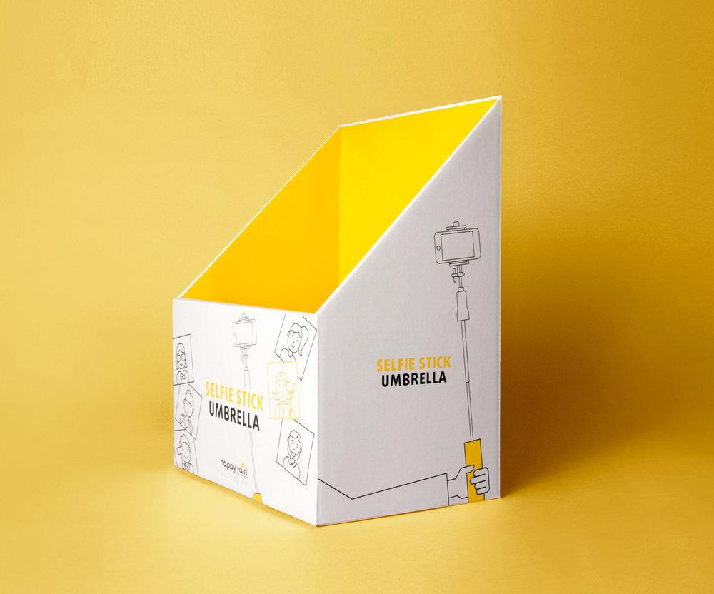 Display des happy rain Selfie Stick Umbrella für den POS / gestaltet von der Werbeagentur sons of ipanema aus Köln