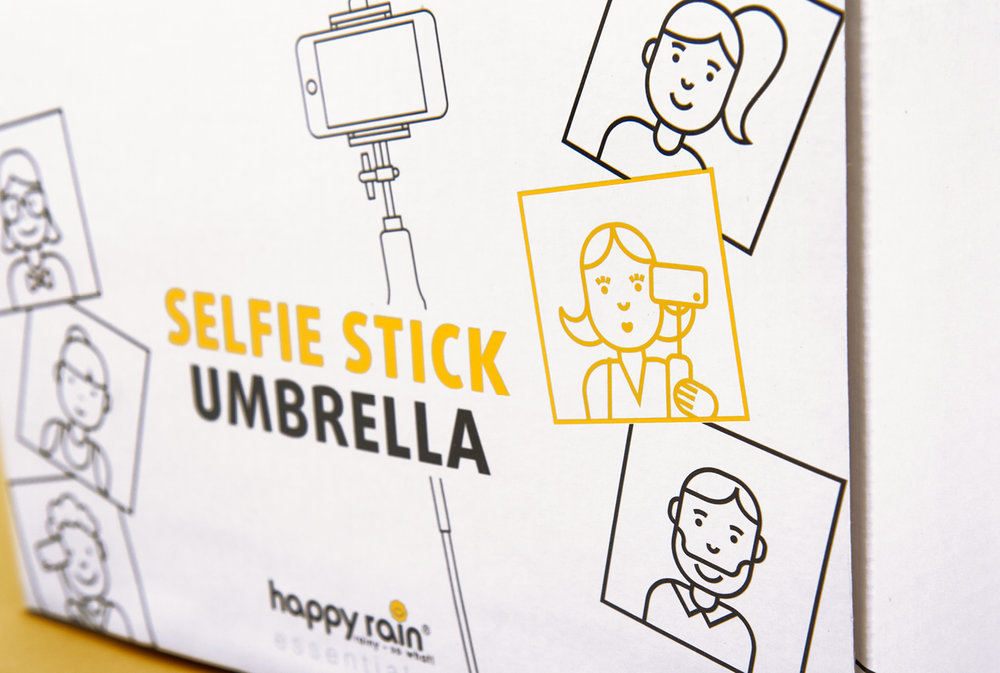 Clos-Up der Verpackung happy rain Selfie Stick Umbrella / Konzeption und Design von der Corporate Design Agentur sons of ipanema aus Köln