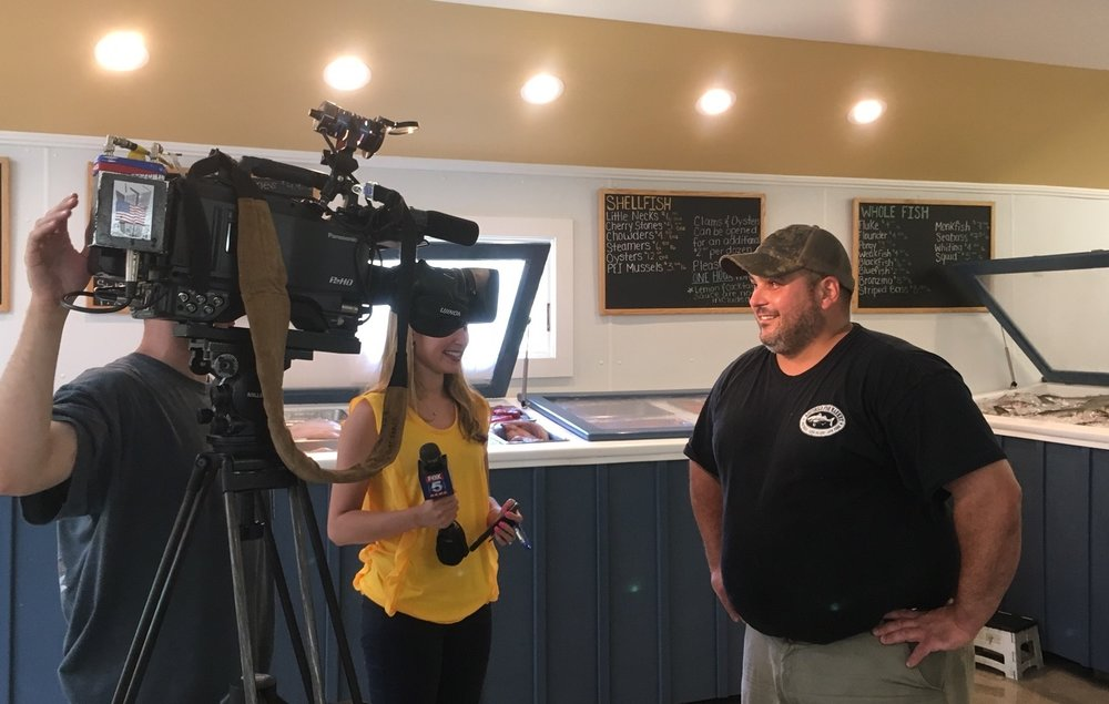 Fox 5's Jodi Goldberg interviewing Southold Fish Market owner Charlie Manwaring