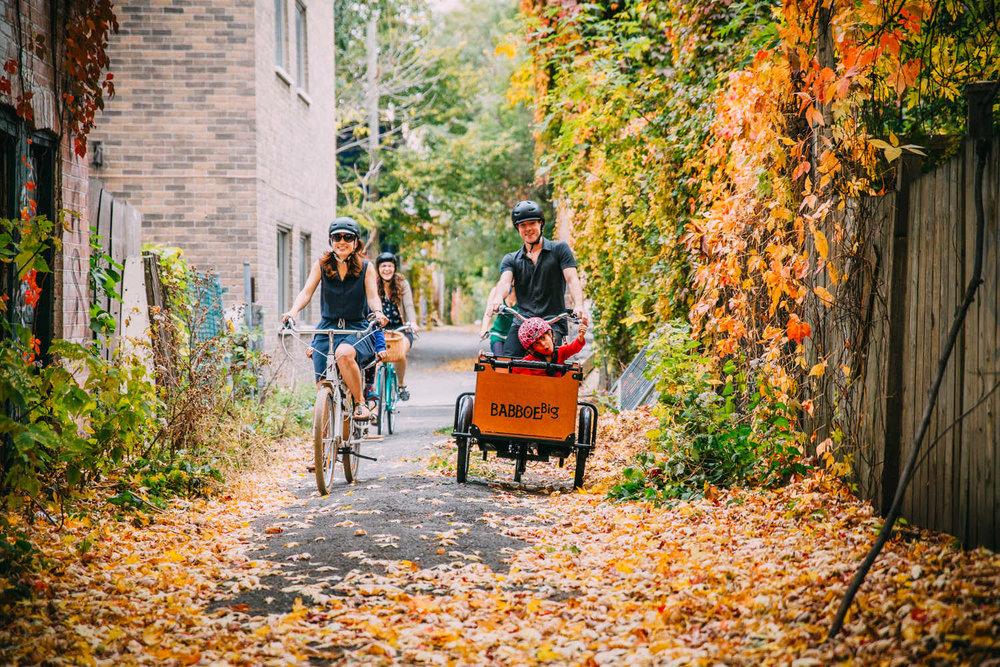 family ride laneway Plateau Montreal