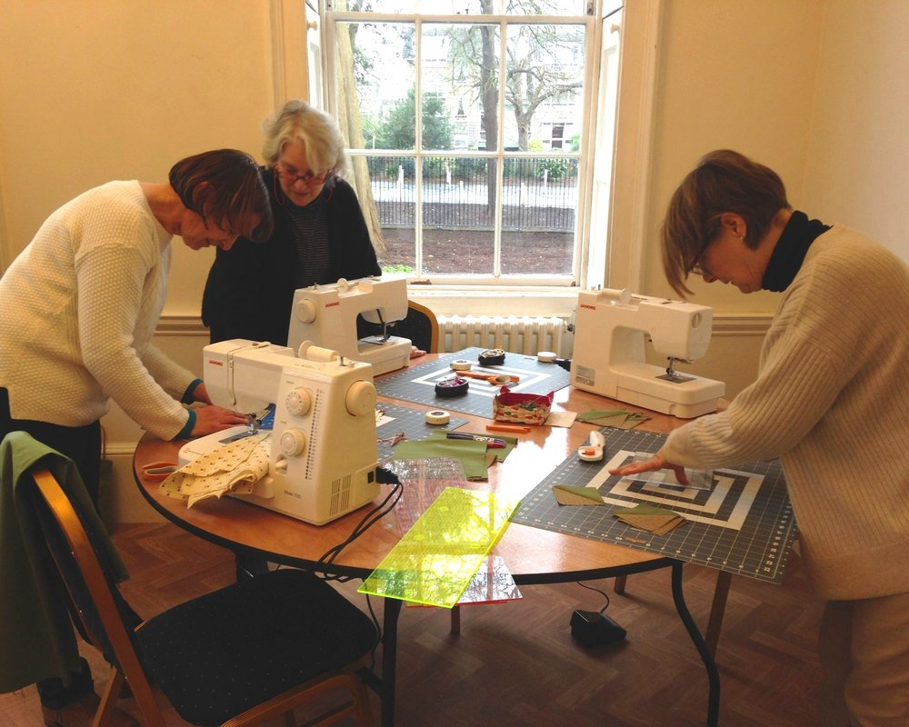 Members of the Quilting Academy hard at work in Bell House